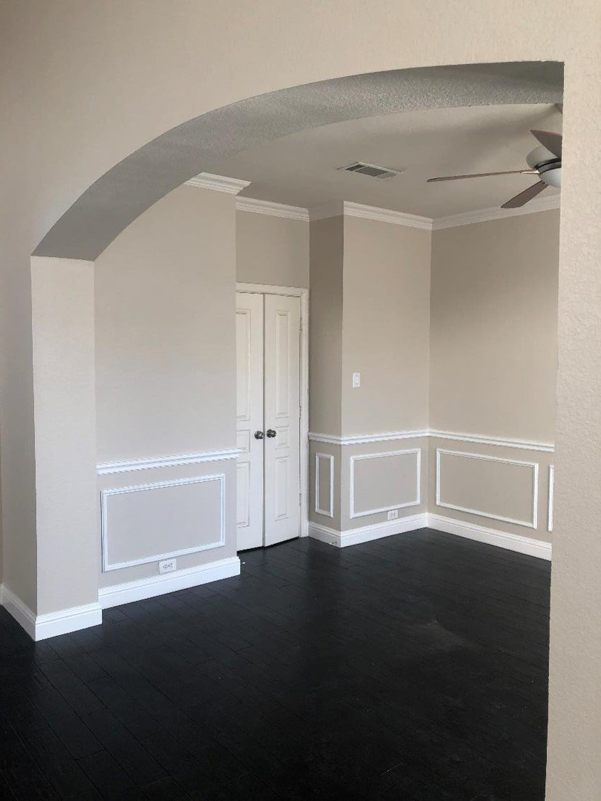 White Trim And Grey Walls With Arch Entry